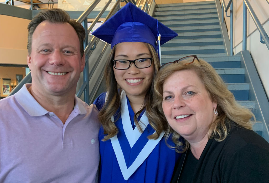 Photo of Ryan Tompkins with his daughter, Quinn, and wife, Cathy