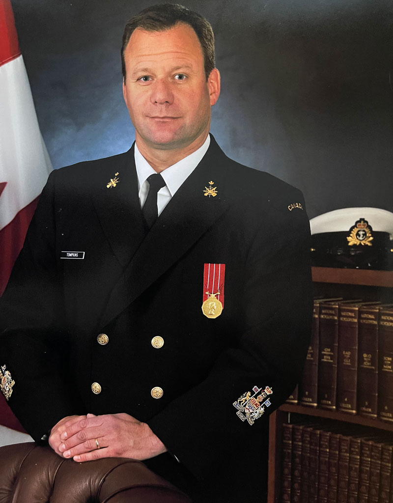 Headshot of Ryan Tompkins in his Navy uniform