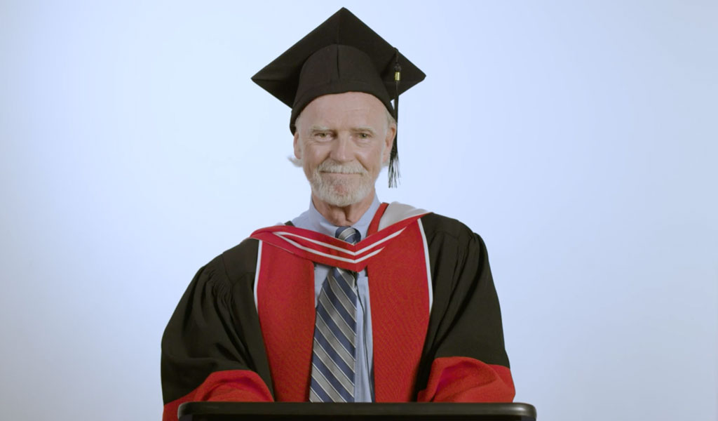 YU President Dr. Rick Davey in gown and cap