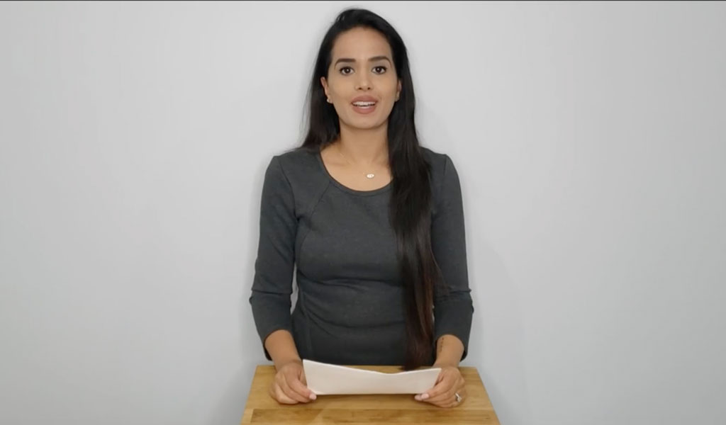 MACP Valedictorian Amrita Sandhu holding speech notes