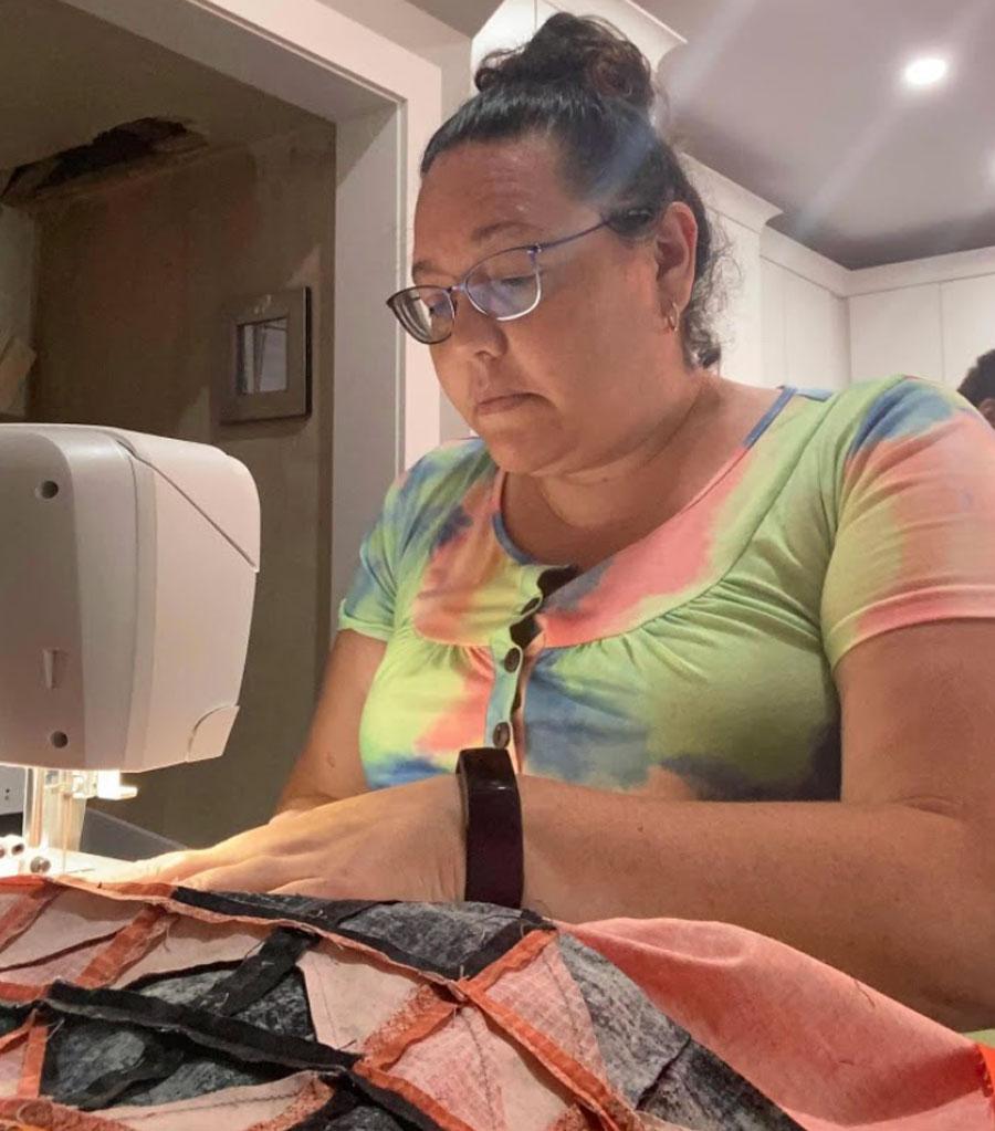 Vanessa Genier at work on a sewing machine