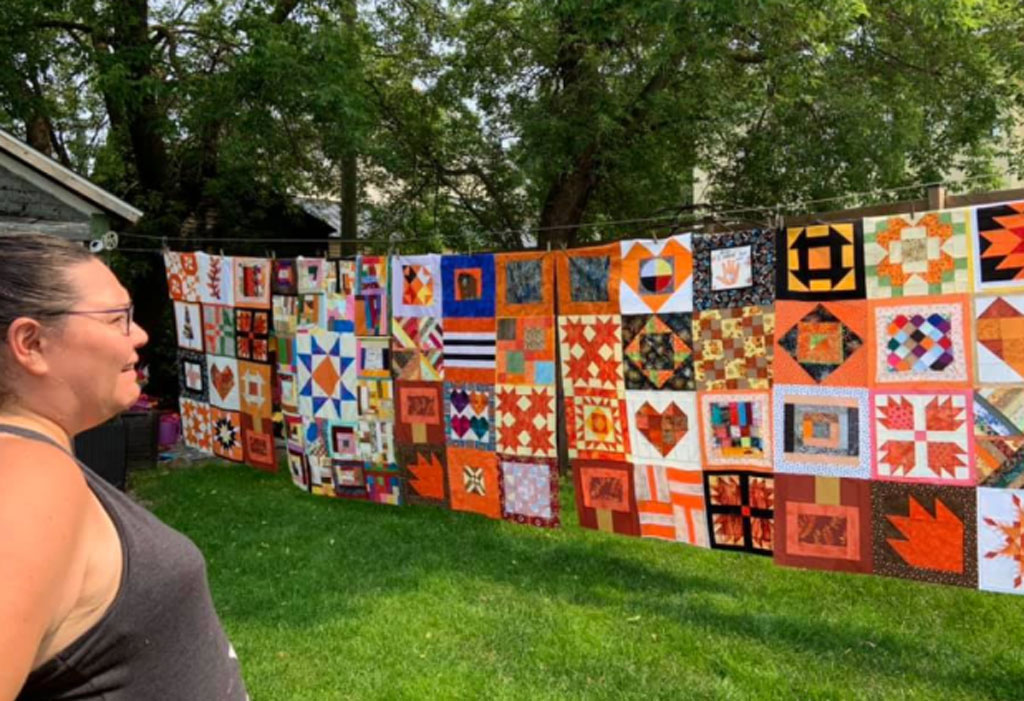 Vanessa Génier and quilts on display